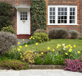 Red brick house with front garden